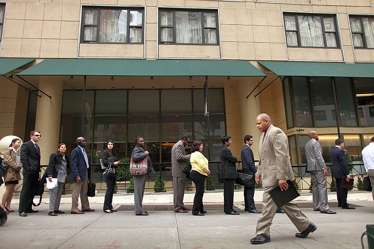 Job seekers line up to attend a job fair in New York City