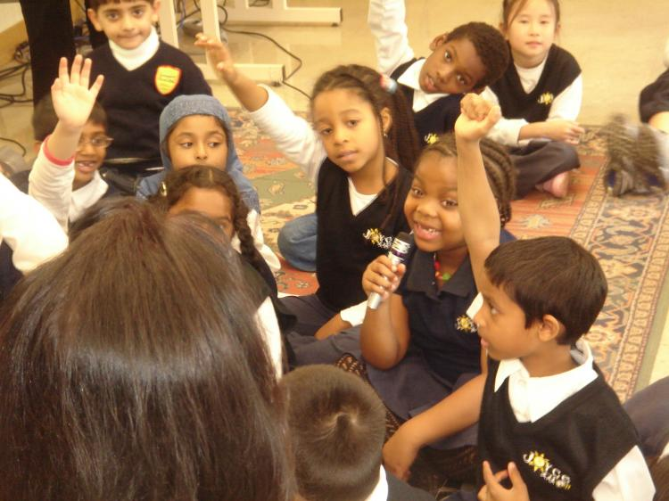 Children at Joyce Public School in Toronto use a microphone to participate in National Show and Tell Day.  (FrontRow)