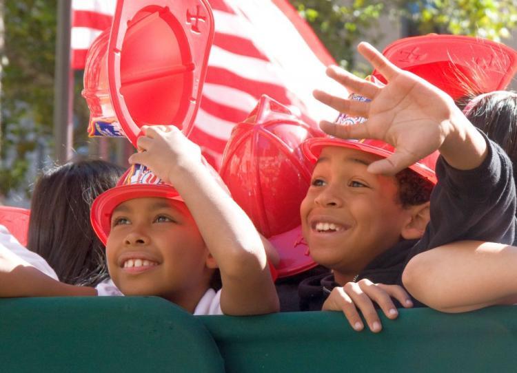 Elementary school kids sworn in as junior firefighters on Monday. (Jasper Fakkert/The Epoch Times)