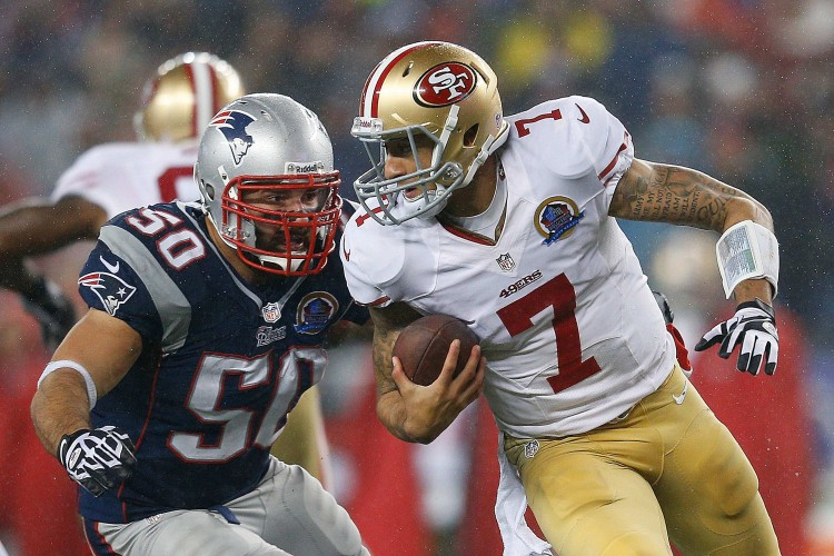 Colin Kaepernick of the San Francisco 49ers evades Rob Ninkovich of the New England Patriots on Sunday, Dec. 16, 2012 at Gillette Stadium in Foxborough, Mass. (Jim Rogash/Getty Images)
