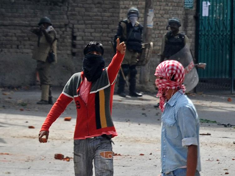 Masked Kashmiri protestors walk away from Indian police during clashes in Srinagar on September 15, 2010. (Tauseef Mustafa/AFP/Getty Images)