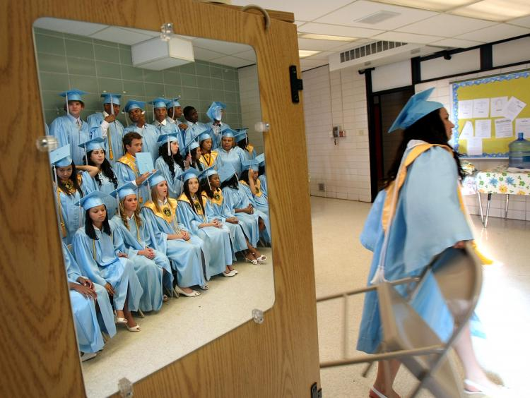 Members of the 2008 graduating class of South Plaquemines High School wait for the start of their commencement May 21, 2008 in Boothville, La. South Plaquemines High School was formed in the aftermath of Hurricane Katrina by merging three destroyed high schools. (Mario Tama/Getty Images)