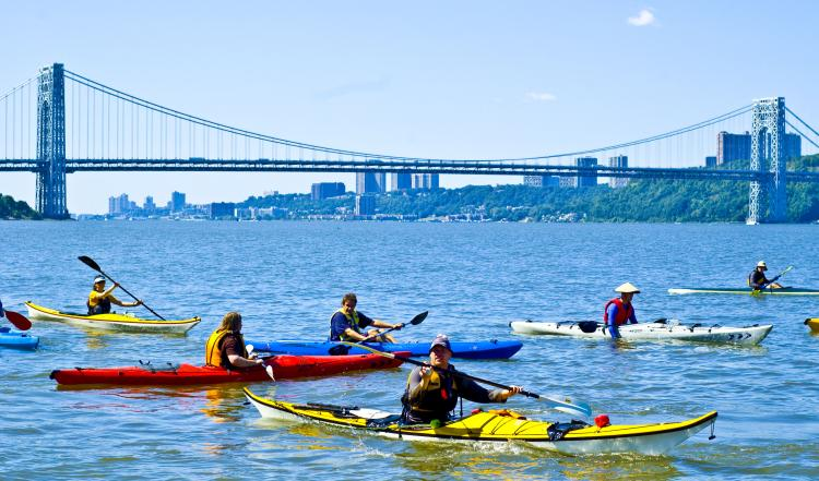 FLOATING THE HUDSON: The George Washington Bridge drapes across the water as a crew of kayakers set out for a journey down the river.  (JOSHUA PHILIPP/THE EPOCH TIMES)
