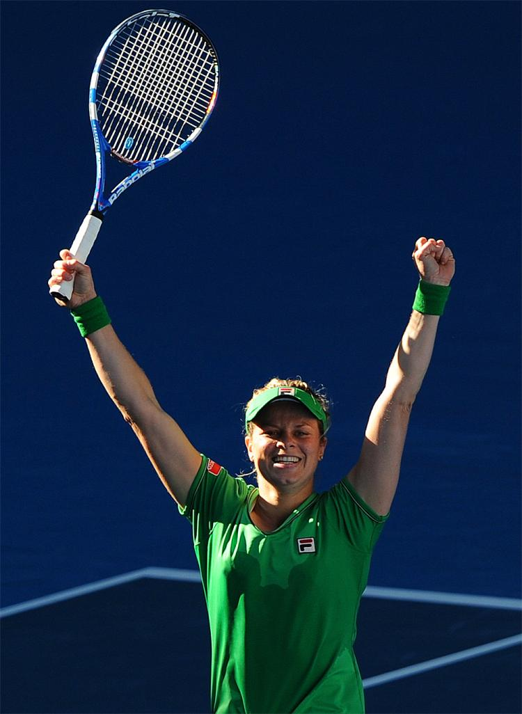 Kim Clijsters celebrates beating Vera Zvonareva in their semifinal women's singles match at the Australian Open tennis tournament. (William West/AFP/Getty Images)