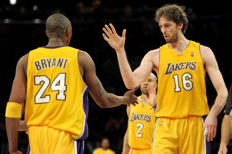 Kobe Bryant (left) and Pau Gasol combined for 61 of the Lakers' 128 points in Monday's crushing defeat of the Phoenix Suns. (Harry How/Getty Images)
