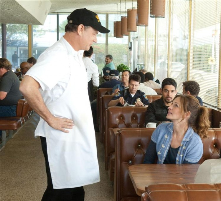 SOCIAL EXPERIENCE: Larry (Tom Hanks) flirts with Mercedes (Julia Roberts) while Dell (Wilmer Valderrama) looks on in the romantic comedy 'Larry Crowne.' (Bruce Talamon/Vendome International, LLC)