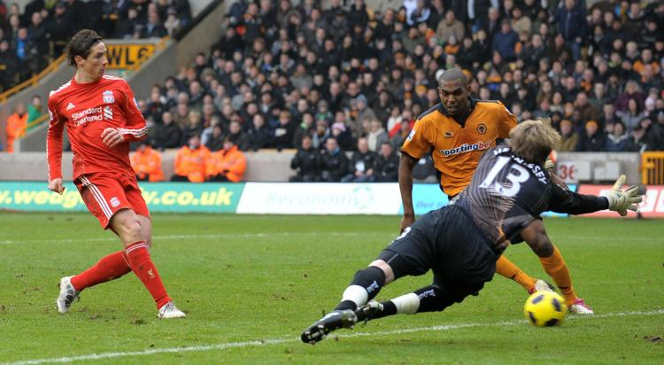 Liverpool's Fernando Torres scores the opening goal of the game at Wolves on Saturday. (Andrew Yates/AFP/Getty Images)