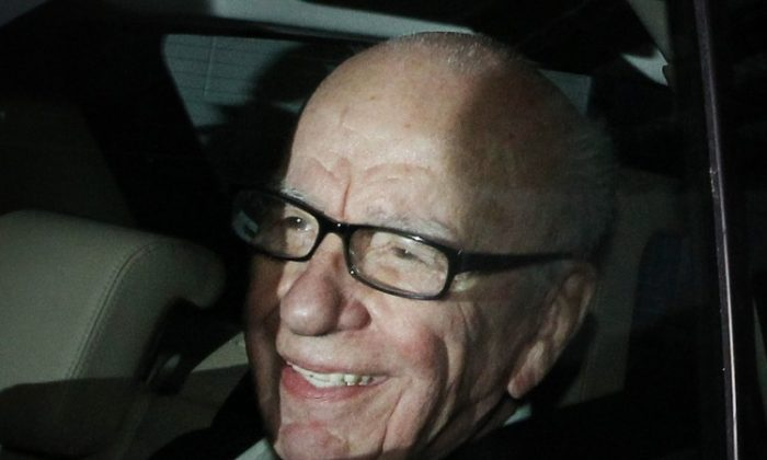 Rupert Murdoch, chief executive officer of News Corp., is seen as he leaves the New International's headquarters on July 13.  (Peter Macdiarmid/Getty Images)
