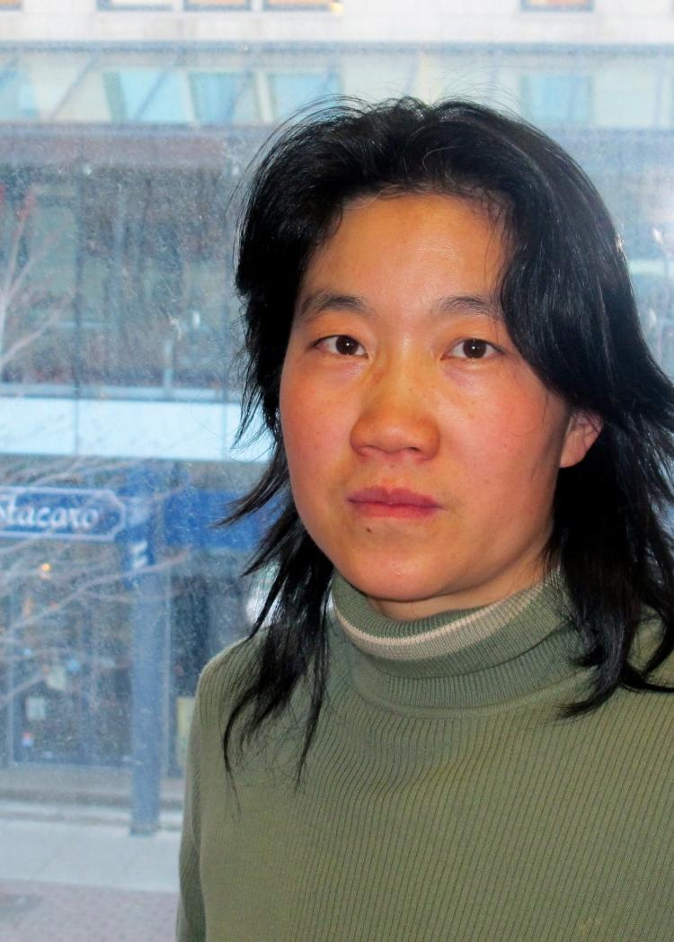 Democracy activist Maggie Wenzhuo Hou says ongoing problems with her Internet and phone connections are the work of Chinese security agents operating in Canada. (Pam McLennan/The Epoch Times)