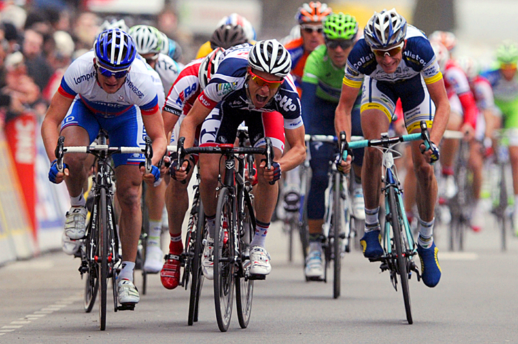 Gianni Meersman (C) sprints to victory in Stage Four of the Paris-Nice cycling race. (Pascal Pavani/AFP/Getty Images)