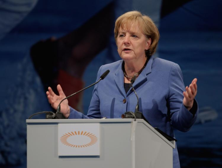 UNDER PRESSURE: German Chancellor Angela Merkel gives a speech on May 14 in Munich. Merkel has become less popular among some Germans for her support of the European currency rescue bill.  (Alexandra Beier/Getty Images)