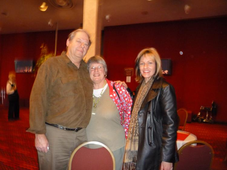 Ms. Mimi Boheme (R), an artist and art educator, attends the show with her parents, Nancy and Don, while visiting San Diego.