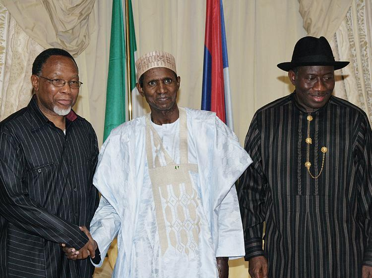 Nigerian President Umaru Musa Yar'adua (C) poses with South African Deputy President Kgalema Motlanthe (L) and Nigerian Vice-President Goodluck Johnatan on Nov. 13, 2009 at the Presidential Villa in Abuja, during a courtesy visit in Nigeria. (Wole Emmanuel/AFP/Getty Images)