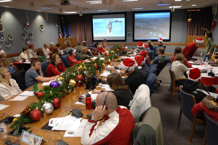 SANTA TRACKING: Santa trackers busy informing children of the whereabouts of Santa Claus on Christmas Eve at the NORAD Tracks Santa Operations Centre at Peterson Air Force Base in Colorado. (NORAD and USNORTHCOM Public Affairs)