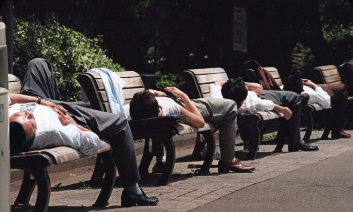 NAPPING: These Japanese businessmen are napping after the noontime meal, which helps enhance brain function, energy, mood, and productivity. Napping also helps regulate the sleep-wake cycles. (Oshikazu Tsuno/AFP/Getty Images)