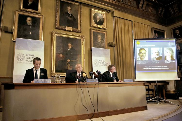 (From L) Photos of Venkatraman Ramakrishnan and Thomas Steitz of the US and Israel's Ada Yonath are displayed on a screen as they win the Nobel Chemistry Prize 2009 for their studies on the ribosome, on October 7, 2009 in Stockholm. (Olivier Morin/AFP/Getty Images)