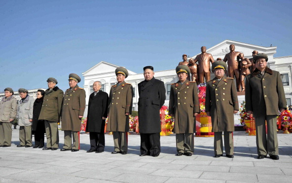 This photo released by North Korea's official Korean Central News Agency on Feb. 16 shows North Korean leader Kim Jong-Un (4th R) and senior senior officials from the party. (KNS/AFP/Getty Images)