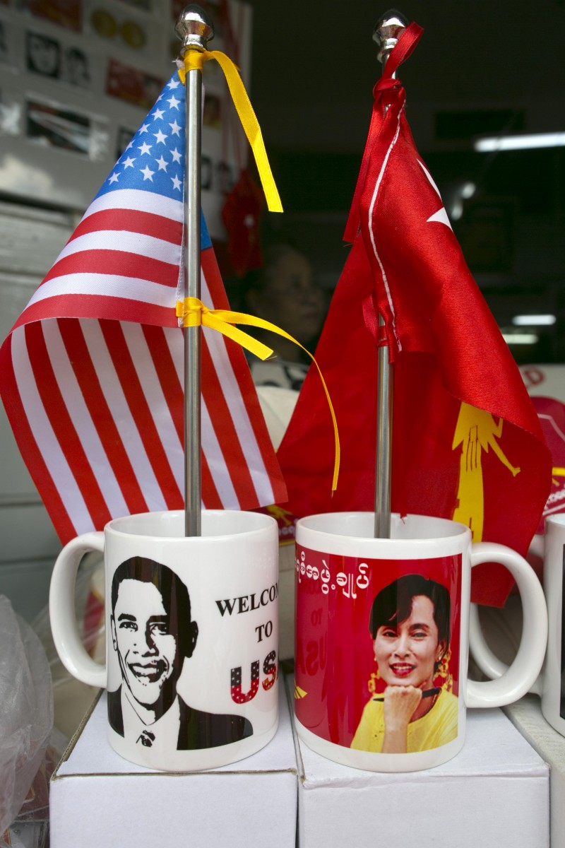 Mugs and flags showing US President Barack Obama and Burmese opposition leader Aung San Suu Kyi are displayed in a shop in Yangon Burma as the city prepares for the US Presidents forthcoming visit on November 16. (Photo by Paula Bronstein/Getty Images)