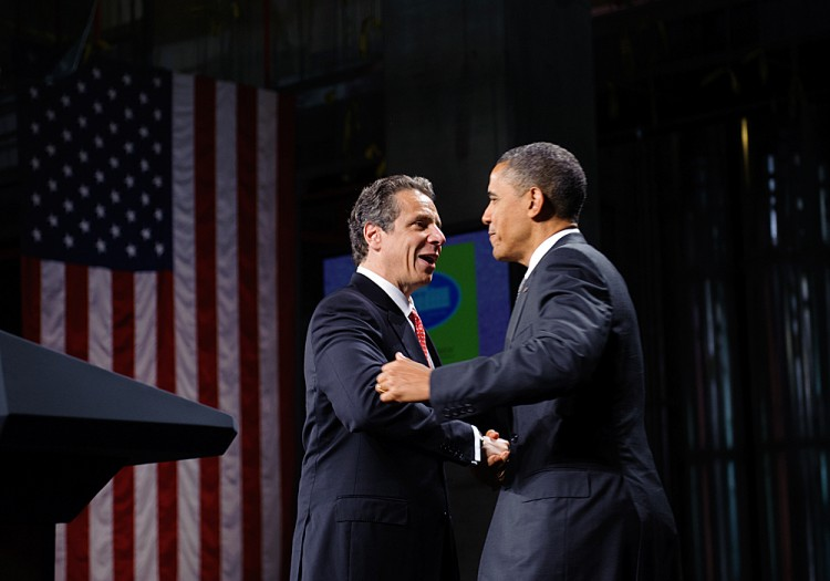President Barack Obama embraces New York Governor Andrew Cuomo