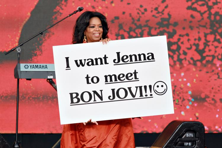 SYDNEY, AUSTRALIA - Oprah Winfrey holds up a poster during the first taping of the 'Oprah Winfrey Show' at the Sydney Opera House on December 14, 2010 in Sydney, Australia. (George Burns/Harpo Productions Inc. via Getty Images)