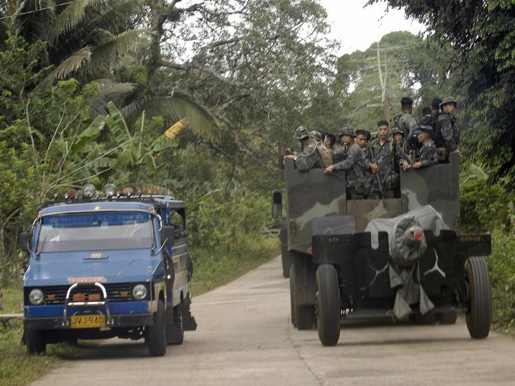 A truckload of marine soldiers carrying a howitzer cannon travel on a road in southern Jolo island on Feb. 12, 2009. Marines killed a senior leader of an al-Qaeda militant group on Sunday.  (Therence Koh/AFP/Getty Images)
