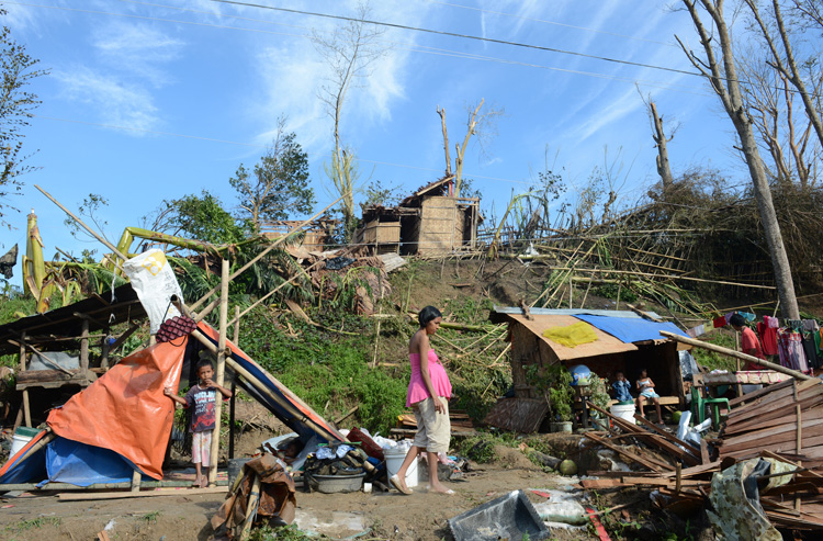 Residents rest at their makeshift homes in Montevista town, Compostel