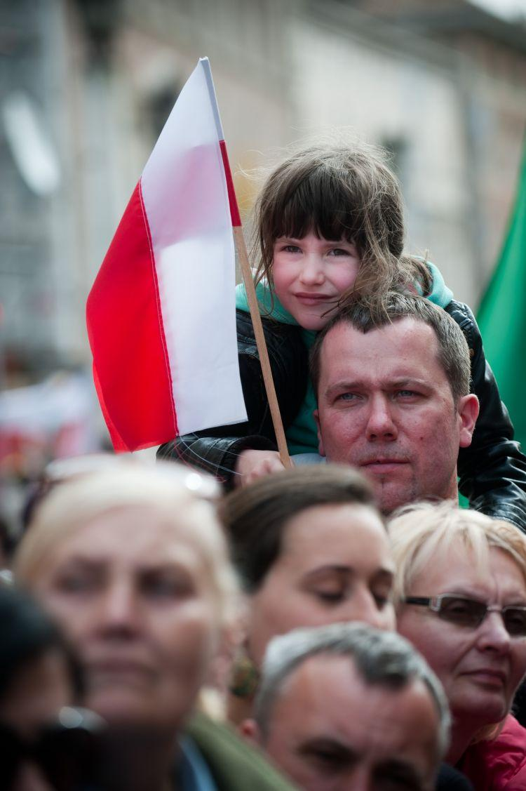 A POLISH POPE: A boy holds a Polish flag at the beatification ceremony of Pope John Paul II at St. Peter's Square on May 1 in Vatican City. For Poles, the pope holds a special place in their hearts as the main force that lead to the fall of communism in Poland and ultimately the Soviet Union. (Giorgio Cosulich/Getty Images)