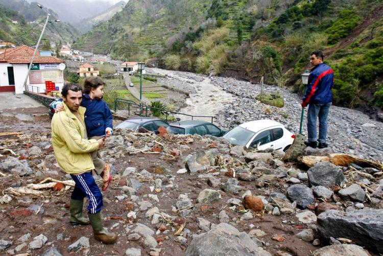 Villagers are pictured near Ribeira Brava, in Funchal, Madeira Island, on Feb. 21. Violent rainstorms left at least 40 people dead on the Portuguese Atlantic island of Madeira, Interior Minister Rui Pereira said, adding that Lisbon could seek EU help following the disaster. (Gregorio Cunha/AFP/Getty Images))