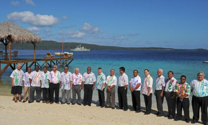 Leaders from 15 Pacific states pose for the official photo during the 41st Pacific Islands Forum leaders' retreat in Port Havannah on Efate on Aug. 5, 2010. (Torsten Blackwood/AFP/Getty Images)