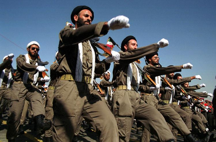 Armed Iranian mullahs (Shiite clerics) march during a military parade in Tehran marking the 20th anniversary of the war with Iraq. (Atta Kenare/AFP/Getty Images)
