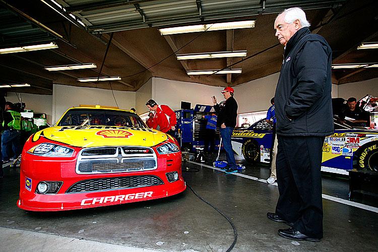 Team owner Roger Penske looks at the 22 Shell/Pennzoil Dodge of A.J. Allmendinger in the garage during practice for the NASCAR Sprint Cup Series Daytona 500. (Tyler Barrick/Getty Images for NASCAR)