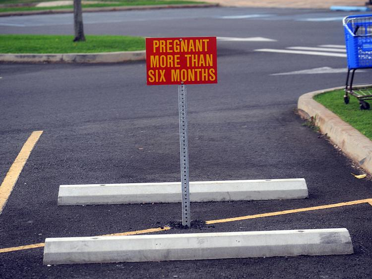 A parking sign warns a restriction for pregnant women at the U.S. Marine Base Hawaii Kailua. (Tim Sloan/AFP/Getty Images)