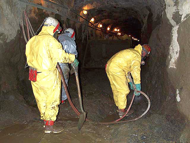 Workers remove mercury contaminated sediments from the Polar Star Mine