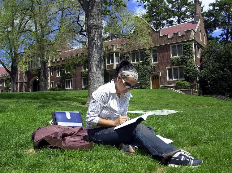 IMPORTANCE OF EDUCATION: A university student doing homework on campus. According to the Canadian Council on Learning, from 1990 to 2007, the number of jobs requiring a post-secondary qualification almost doubled, while the number of jobs that did not require one was halved. (William Thomas Cain/Getty Images)