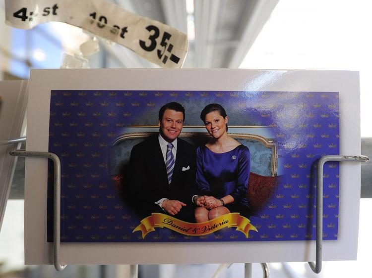 ROYAL MATRIMONY: Close-up of a postcard featuring Swedish Crown Princess Victoria and her fiance, Daniel Westling sitting on a rack near the Royal Castle in Stockholm on May 24, where the royal wedding will be held. Stockholm is awash in merchandising celebrating the marriage, the first for the royal family since the current King and Queen married in 1976. (Olivier Morin/AFP/Getty Images)