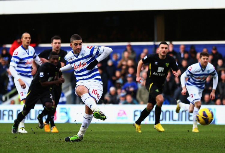 QPR's Adel Taarabt takes a penalty kick in the second half against Norwich City in English Premier League action in London on Feb. 2, 2013. (Paul Gilham/Getty Images)