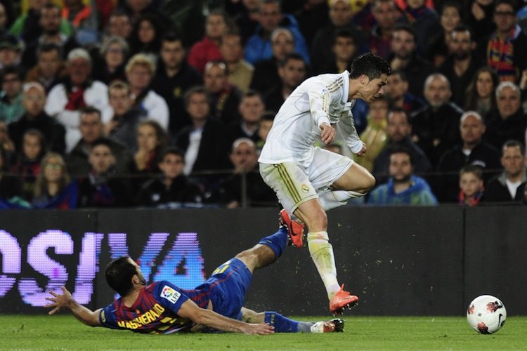 Real Madrid's Cristiano Ronaldo evades Barcelona's Javier Mascherano in the 'El Clasico' matchup at the Camp Nou in Barcelona on Saturday. (Javier Soriano/AFP/Getty Images)