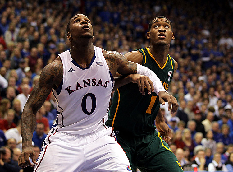 Player of the Year candidate Thomas Robinson (0) of Kansas is averaging 17.7 points and 12.1 rebounds per contest but had 27 and 14 in 92–74 rout of Baylor. (Jamie Squire/Getty Images)