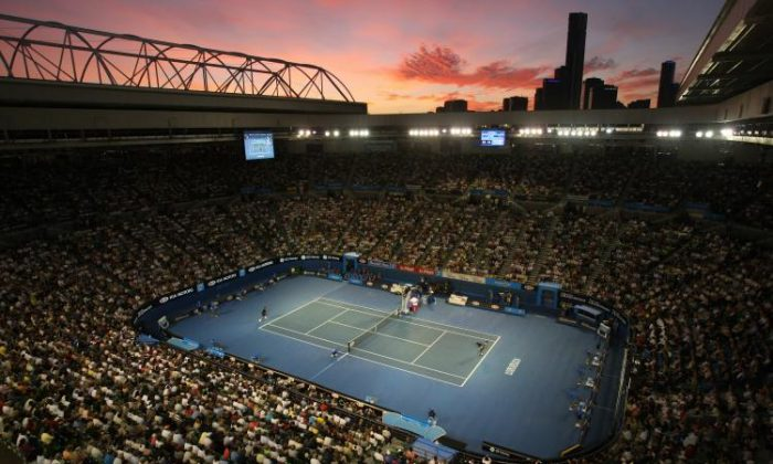 Centre Court ¦The sun sets over Melbourne as French tennis player Jo-Wilfried Tsonga and Serbian  opponent Novak Djokovic play their Men's Singles Final at the 2008 Australian Open tennis tournament at the Rod Laver Arena. (Clive Brunskill/Getty Images)