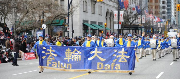 Falun Gong practitioners march in Roger's Santa Clause Parade in downtown Vancouver Dec. 5, 2010. The group says its application to participate in the Chinese New Year Parade has been rejected every year since 2003. (The Epoch Times)