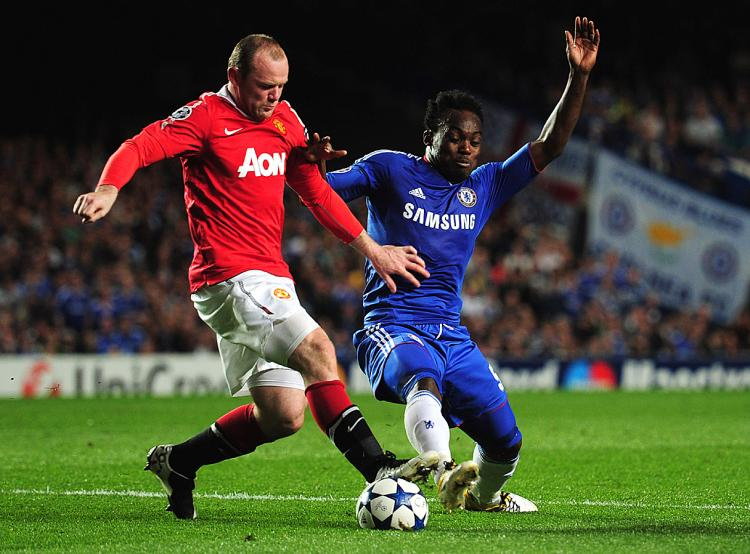 Wayne Rooney of Manchester United battles with Michael Essien of Chelsea during the UEFA Champions League quarter final first leg match between Chelsea and Manchester United. (Shaun Botterill/Getty Images)