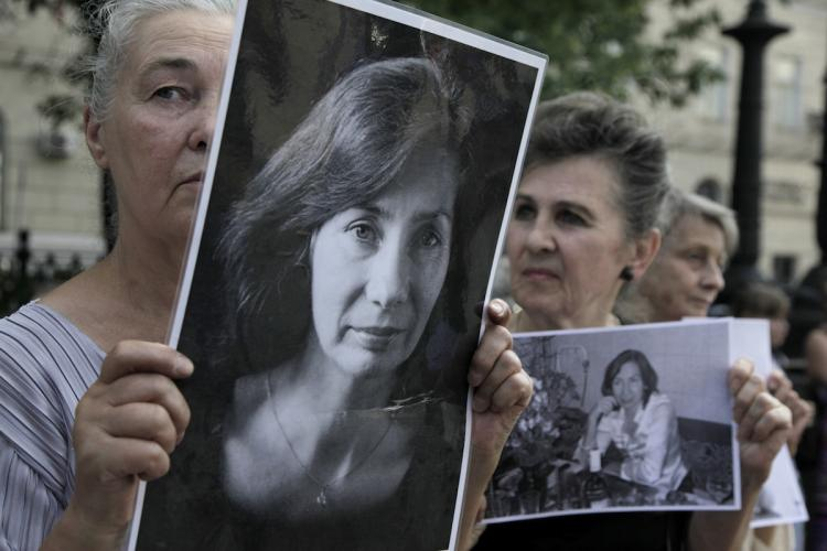SLAIN HERO: Russian activists hold portraits of slain human rights activist Natalia Estemirova in Moscow on July 15, during a rally to mark the one-year anniversary of her killing. (Oxana Onipko/Getty Images)