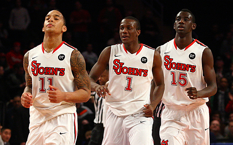 (L-R) D'Angelo Harrison No. 11, Phil Greene No. 1, and Sir'Dominic Pointer No. 15 led the Red Storm to its third straight win Saturday. (Chris Chambers/Getty Images)