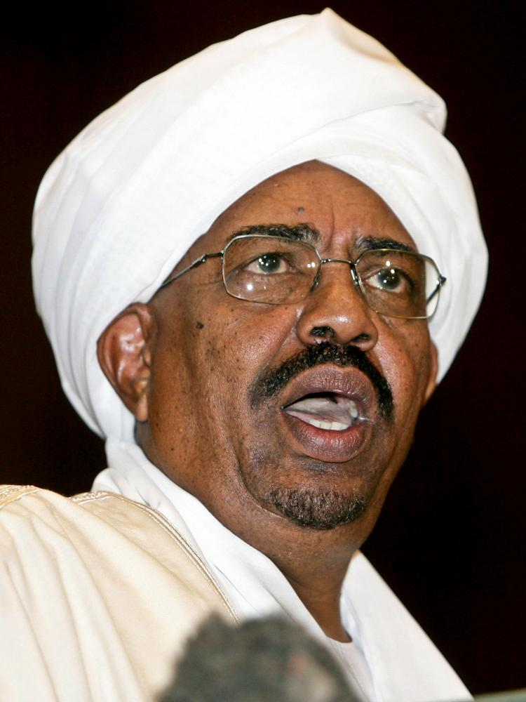 GENOCIDE CHARGES: Sudanese President Omar al-Bashir gives a speech during in Parliament in Khartoum, Sudan, on May 27. On Monday, al-Bashir was charged with genocide by the International Criminal Court.  (Ashraf Shazly/Getty Images)
