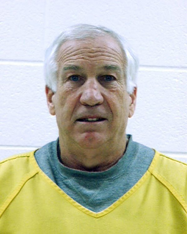 Jerry Sandusky poses for his mugshot