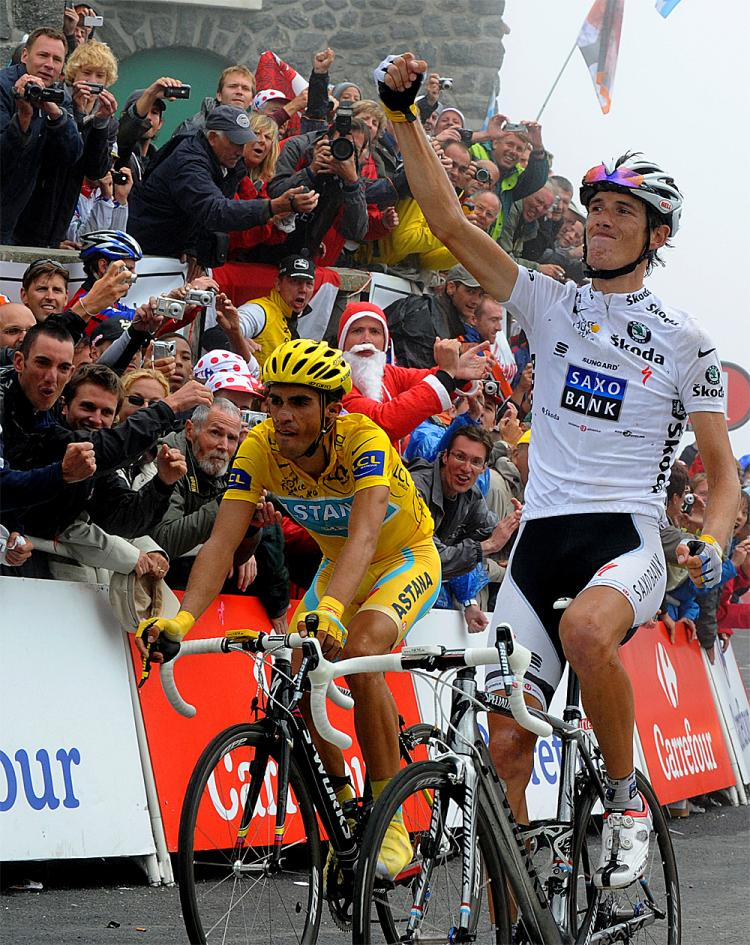 Andy Schleck (R) celebrates on the finish line as he wins Stage 17 of the 2010 Tour de France ahead of Alberto Contador. (Pascal Pavani/AFP/Getty Images)