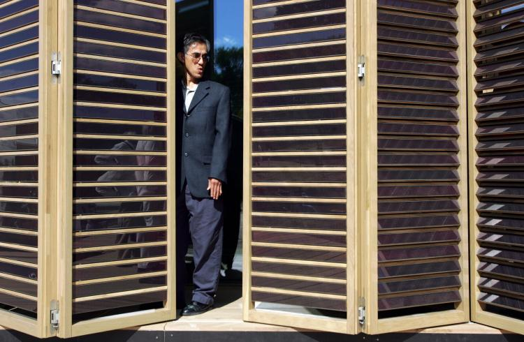 HOME OF THE FUTURE: Somchai Paarporn takes a look at movable shades of solar panels as he visits a home built by the Technische Universitat Darmstadt in Germany during the 2007 Solar Decathlon on in Washington, D.C. (SAUL LOEB/AFP/Getty Images)