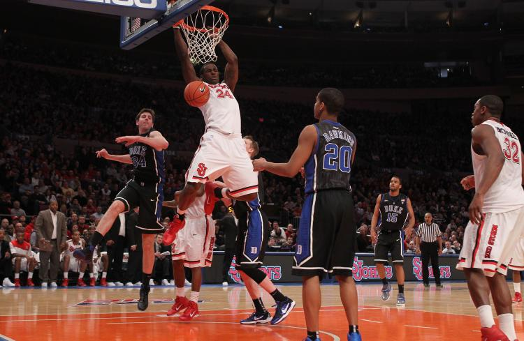 ST. JOHN'S POWER: Red Storm senior forward Justin Burrell slams home a dunk on the defending national champion Duke Blue Devils on Sunday. (Nick Laham/Getty Images)