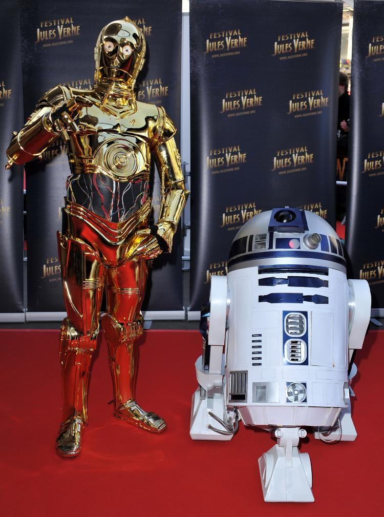 Dynamic Duo: C3PO on the red carpet with his pal R2D2, during the 18th Adventure Film Festival at Le Grand Rex on April 23, in Paris, France at a Tribute to Star Wars V. (Pascal Le Segretain/Getty Images)
