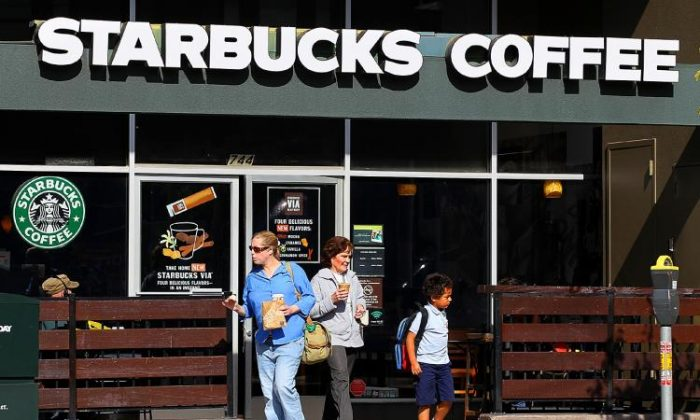 Customers leave a Starbucks Coffee store in San Francisco. (Justin Sullivan/Getty Images)